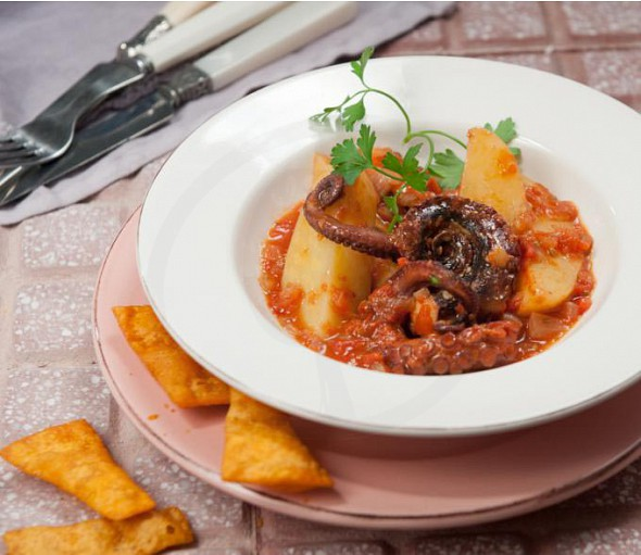 Fish recipe from Corfu (mpourdeto)- octopus combined with lasagne chips with paprika