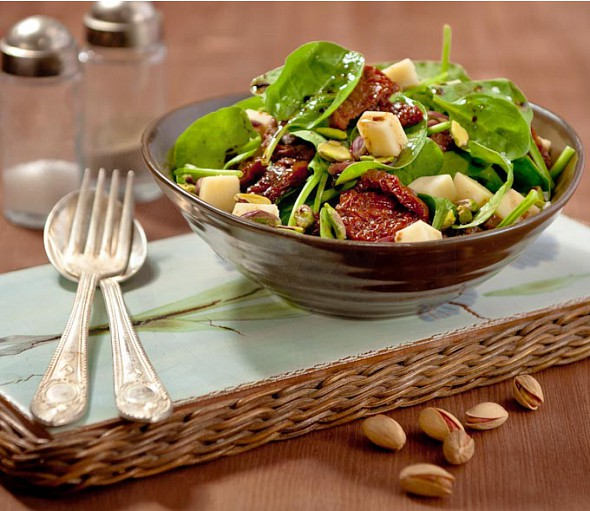 Spinach salad with sun-dried cherry tomatoes and melichloro cheese