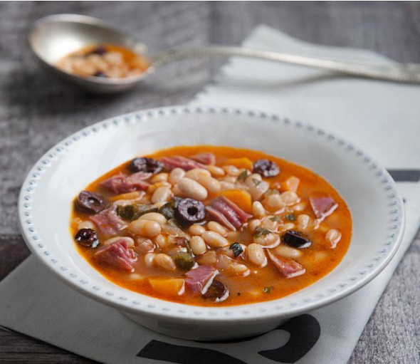 Bean soup with smoked pork, olives and orange