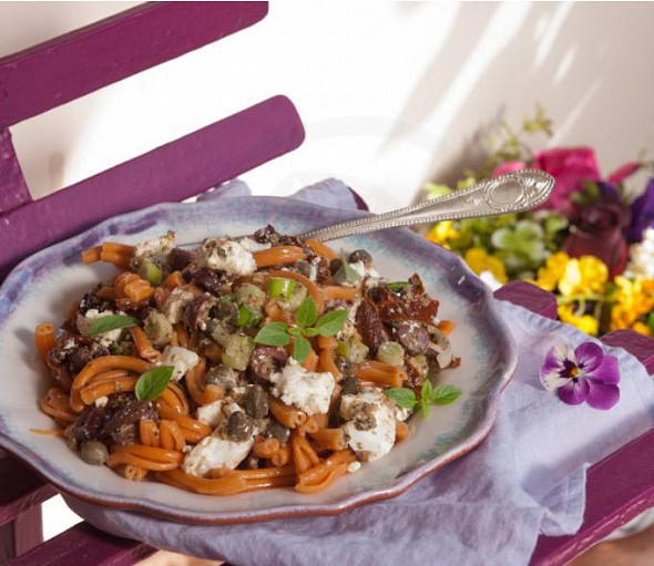 Salad with striftaria pasta, olives, feta cheese and aubergine pesto