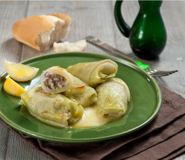 Stuffed cabbage leaves with minced meat in egg-lemon sauce