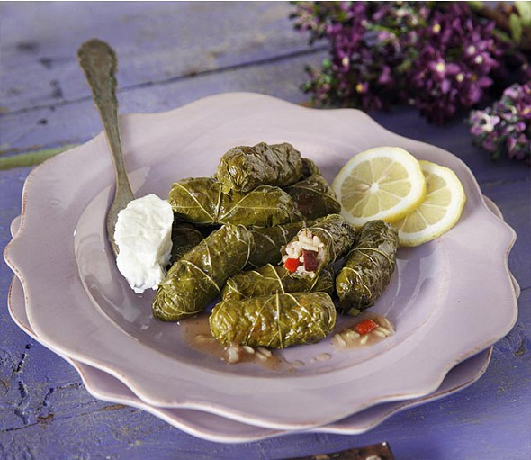 Stuffed vine leaves with olives, peppers and spices