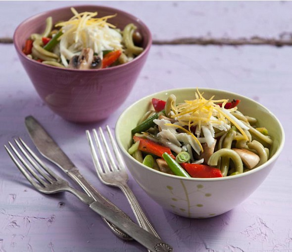 Vegetable stir fry with striftaria pasta, cheese and lemon zest